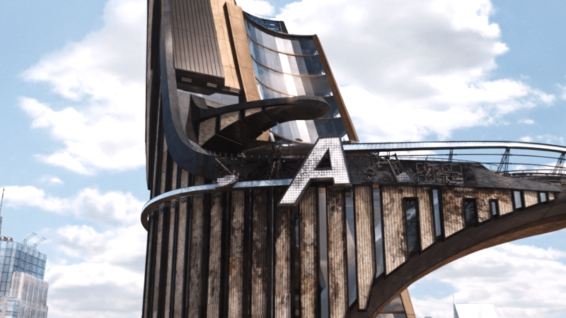 screenshot from The Avengers showing the top of Stark Tower after the battle of New York, with only the giant A remaining of the sign