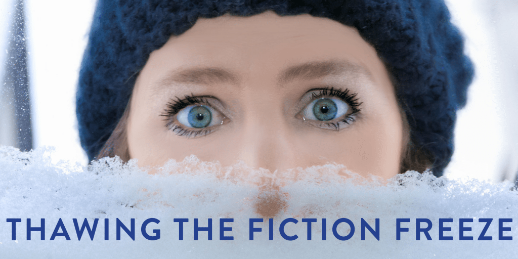 A young blue-eyed woman in a blue knit hat, staring through a snow-covered window looking a bit shocked